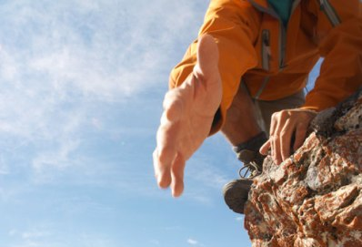 getty_rm_photo_of_climber_reaching_out