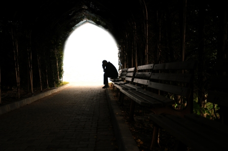 Depressed Man Sitting On The Bench