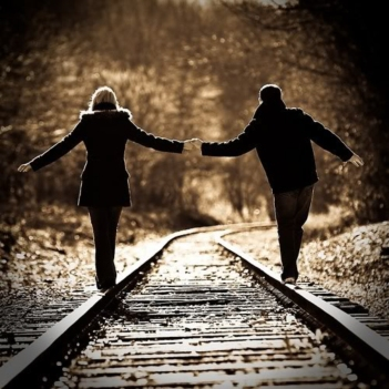 in-love-couple-at-train-tracks-holding-hands-beautiful